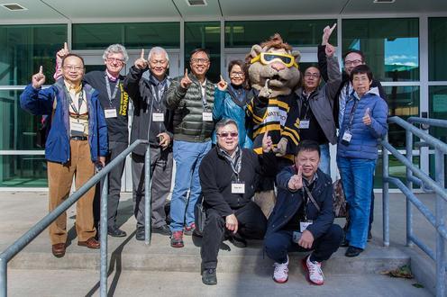 Hong Kong visitors with UW mascot