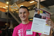 Daniel poses with an flyer bearing his image