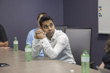 Waterloo grad Sam Pasupalak listens at a boardroom table