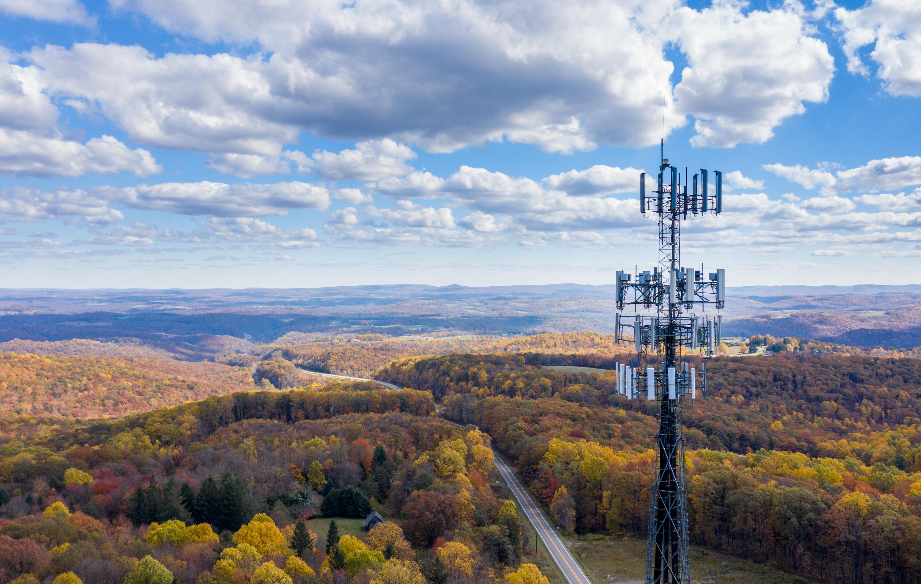 Cell phone tower in front of landscape