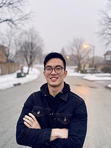 Alan Li standing in the street