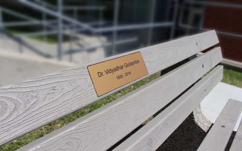 Bench with a plaque honouring Dr. Godambe