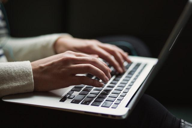 Someone typing on their laptop
