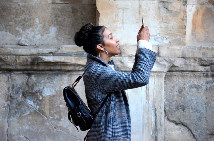 Female holding cellphone in the air