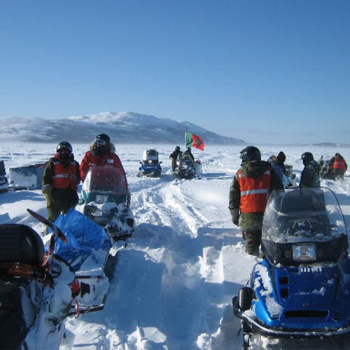 Reserach team on snowmobiles near Labrador