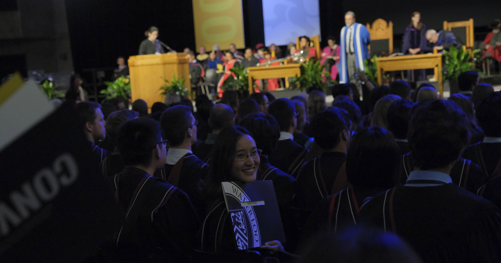 Excited graduate sitting at convocation