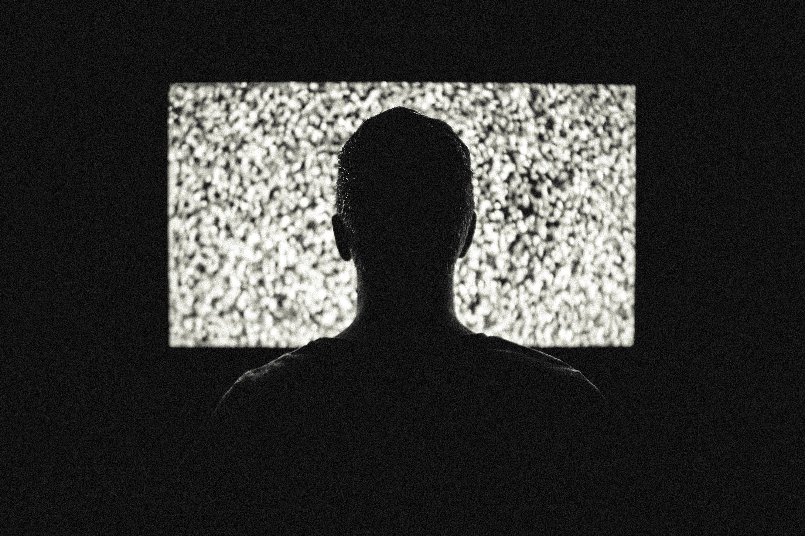Person in front of a screen with static