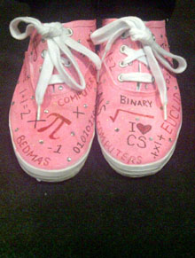 Pink shoes decorated with math and computer science symbols.