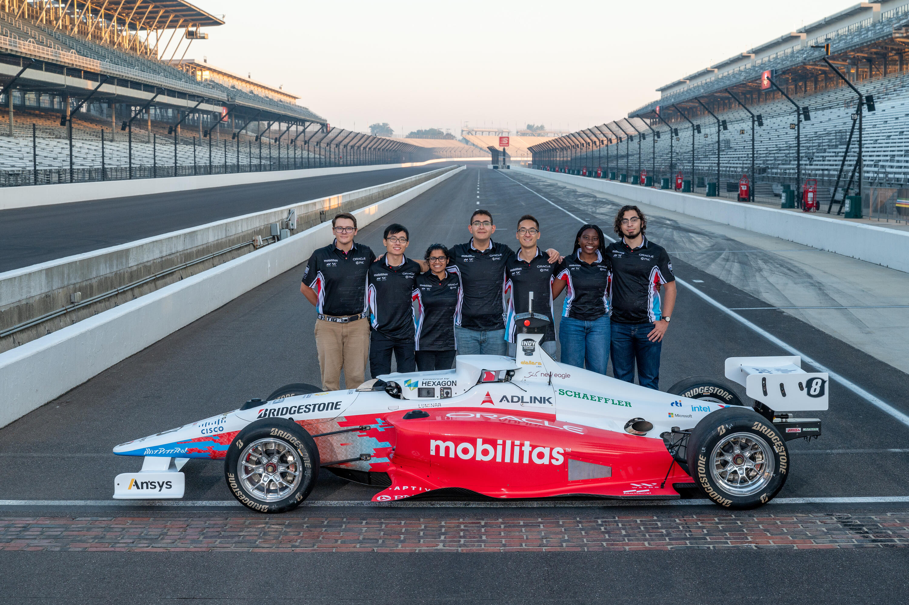 Indy race car and students
