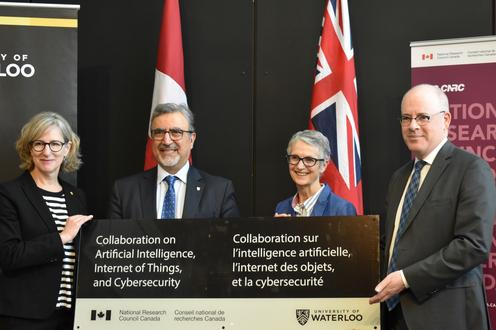 Sandra Banks, Feridun Hamdullahpur, and two NRC representatives