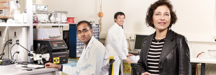 faculty member and lab researchers