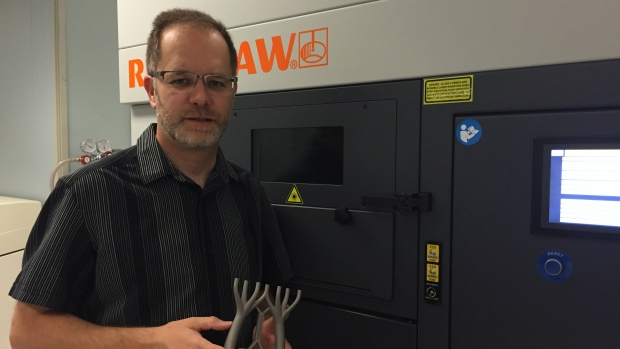 Mark Barfoot, managing director at the Multi-Scale Additive Manufacturing Lab at the University of Waterloo holds a sample 3D-pr