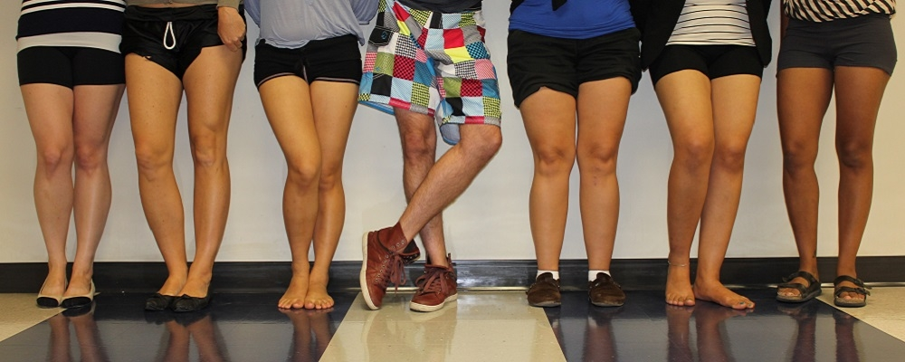 The legs of people in shorts.