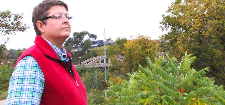 Dementia advocate Mary Beth Wighton gazes at fall landscape.