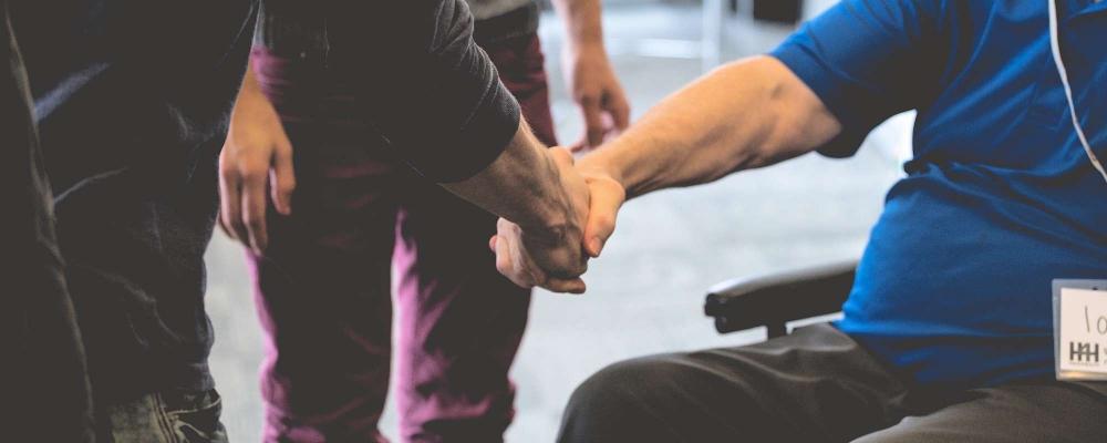 Handshake with man in wheelchair