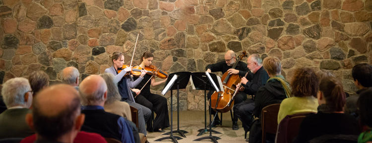A quartet plays in the Grebel Chapel during a noon hour concert