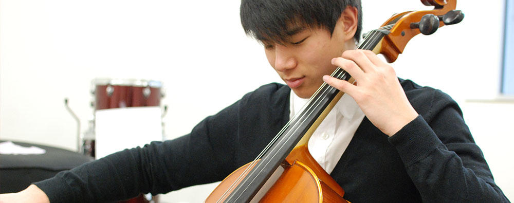 Student playing a cello.