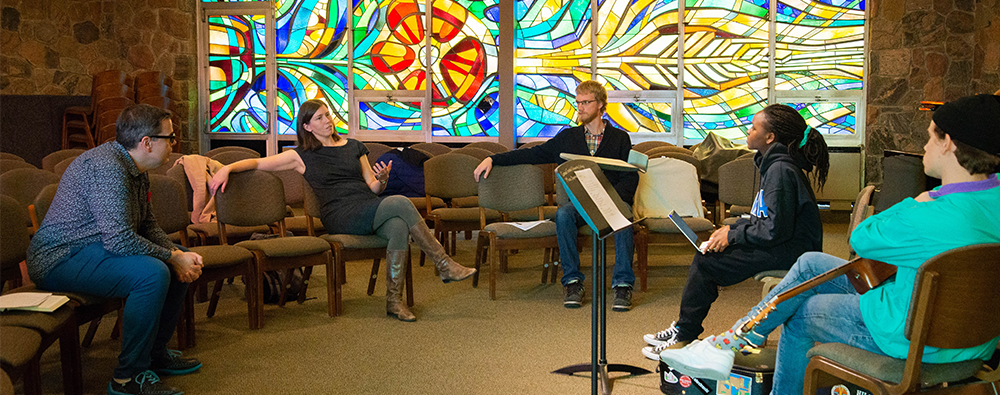 students part of the worship music apprentice program meet with professors in the chapel