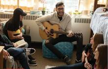 Students play instruments in a GRebel residence room