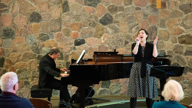 Mary-Catherine sings while paul stouffer plays piano