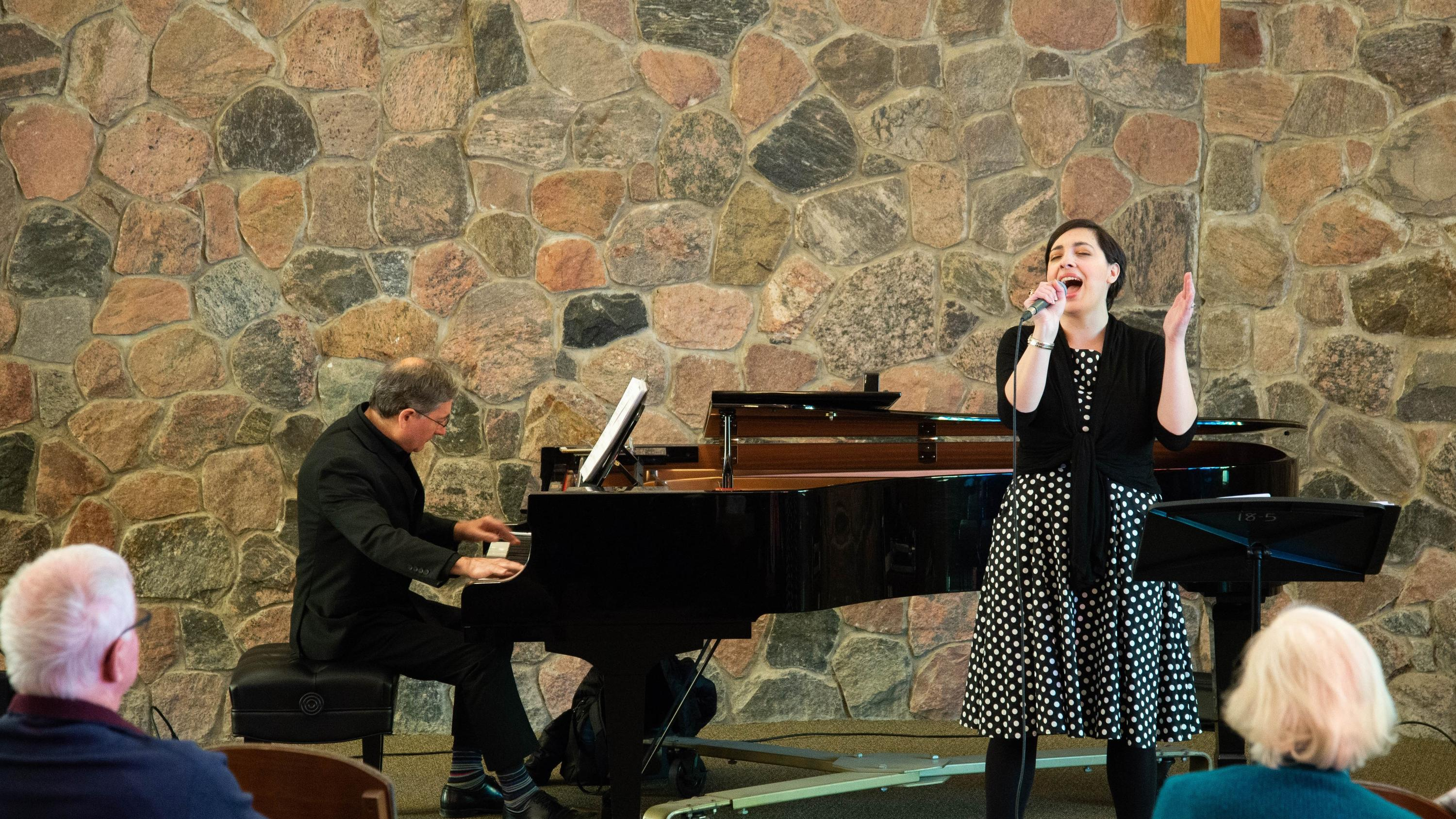 Mary-Catherine Pazzano sings while Paul Stouffer plays piano
