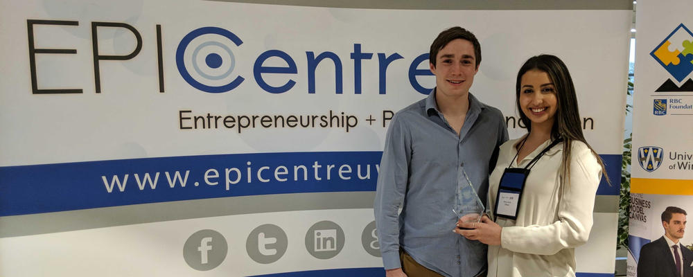 James Oswald and Nina Jeorje from Diffusiv, display their first-place RBC EPIC Business Model Canvas Competition trophy..