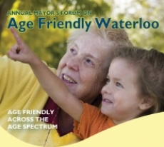 Annual Mayor's forum on Age Friendly Waterloo. Older adult woman and young granddaughter smiling and pointing.