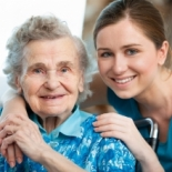 Elderly woman with her caregiver.
