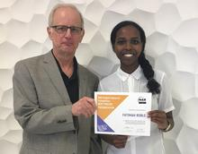 Paul Stolee presenting Fatimah Roble with Best Poster Award