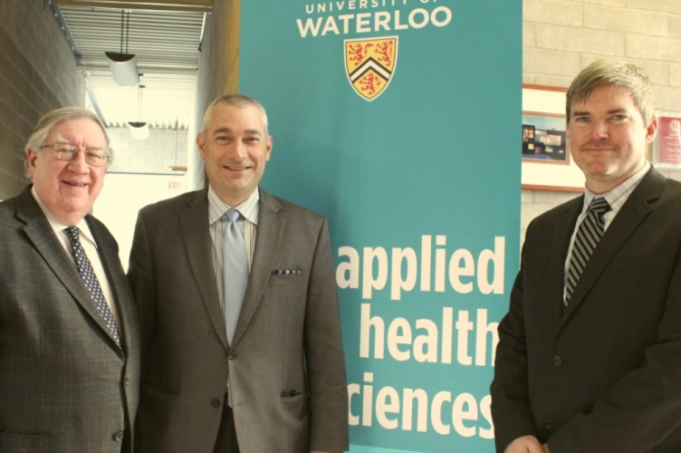 George Dixon, James Rush and Steven Mock in front of banner for Applied Health Sciences.