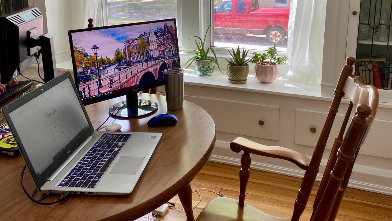 Image of wooden desk with computer on it