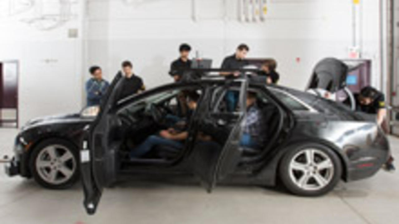 students working on autonomoose car