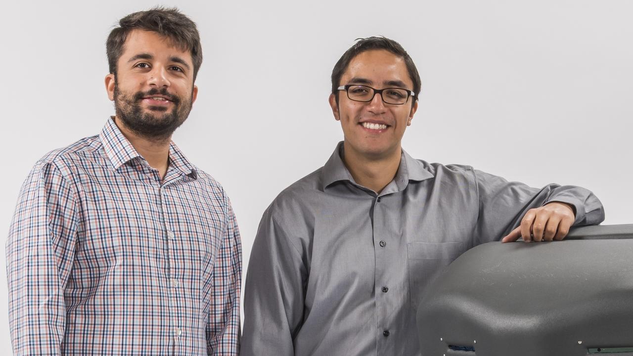 Avidbots founders Pablo Molina and Faizan Sheikh beside Neo
