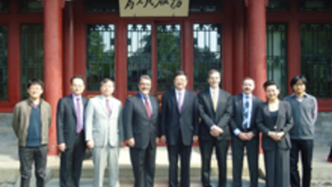 Feridun Hamdullahpur with representatives from the Chinese Ministry of Education