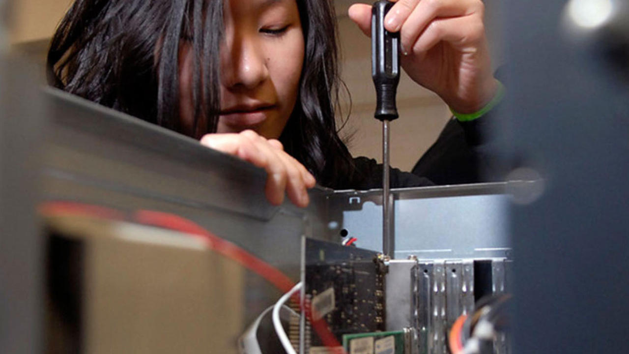 Co-op student building computer hardware