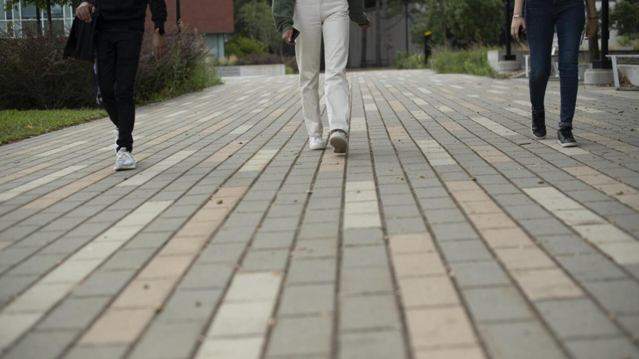 Students walking along campus path