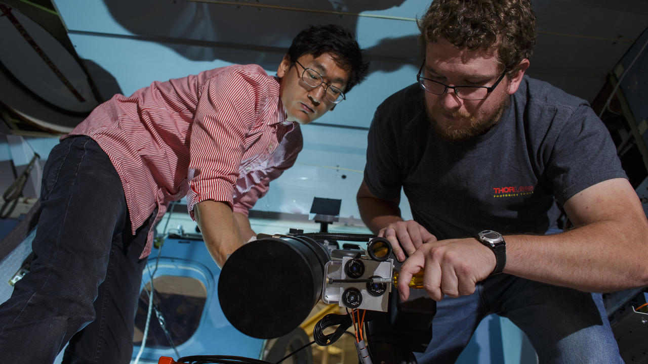 Postdoctoral fellow Jeongwan Jin and PhD candidate Christopher Pugh setting up Bob on the NRC Twin Otter Airborne Research Aircraft. (Source: NRC)