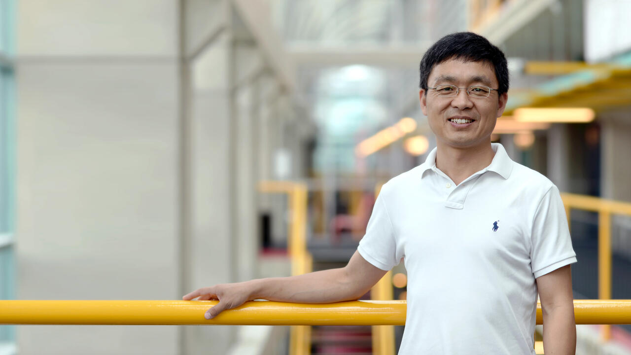 Professor Bin Ma standing inside Davis Centre