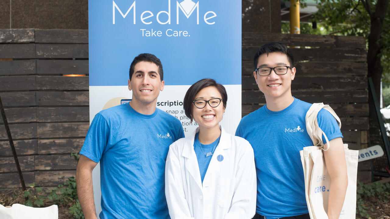 MedMe Health founders standing in front of a sign