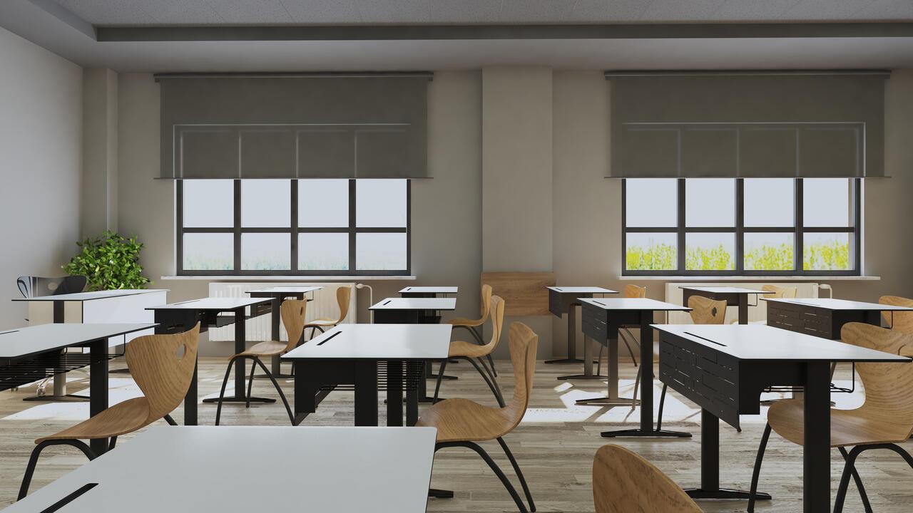 Empty classroom with modern desks, seats and blackboard.