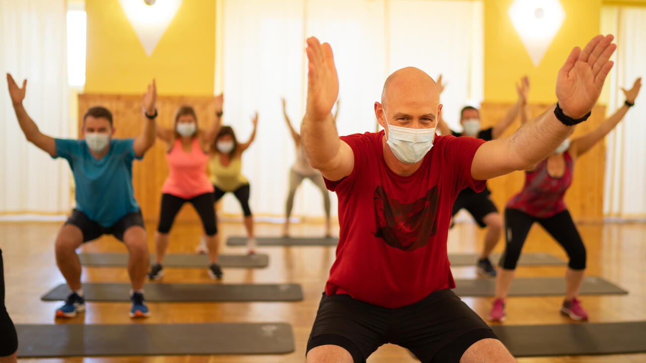 Male instructor leading a fitness class