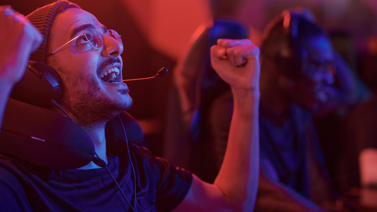 Emotional esports gamer making yes gesture