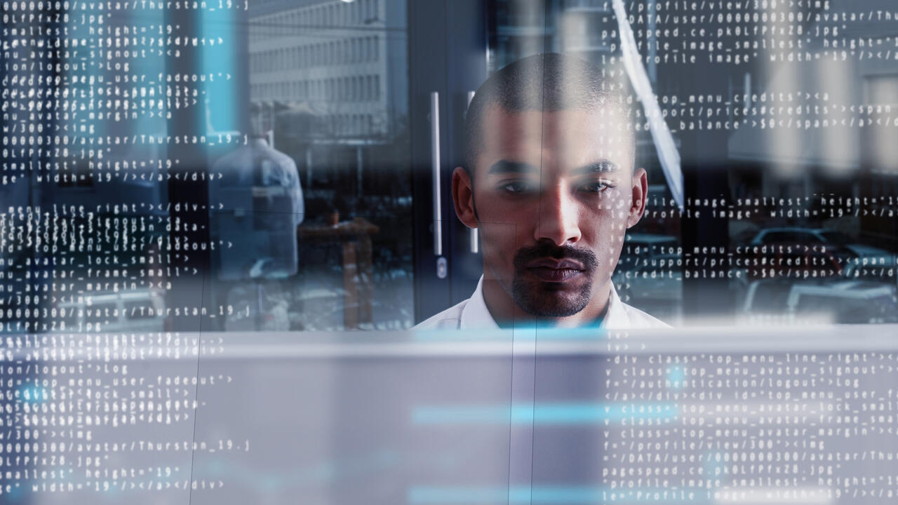 Computer programmer looking through data