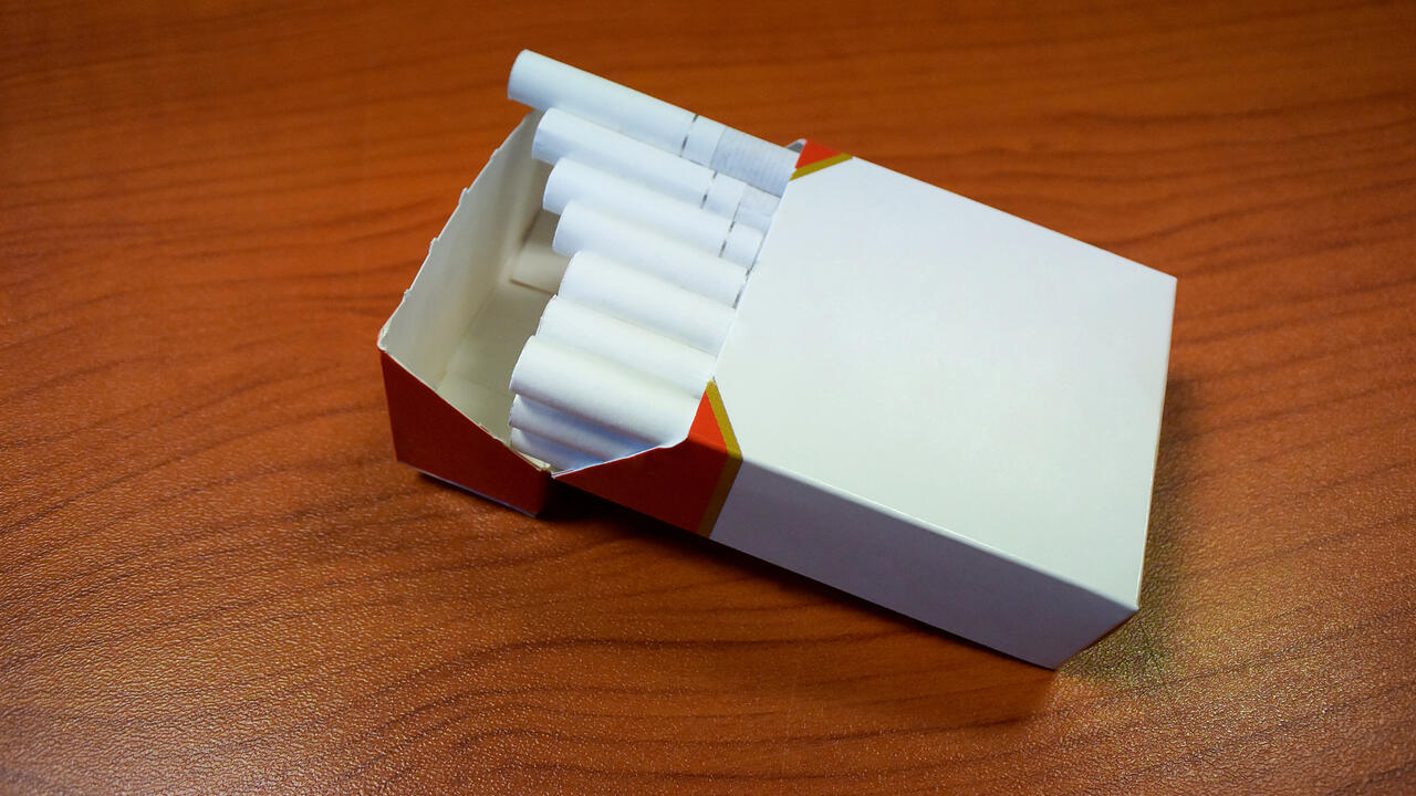 Unbranded cigarette pack on a table