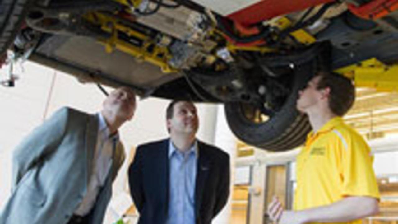 Vice President Ken Kelzer and Executive Director Brandon Vivian examine vehicle modifications