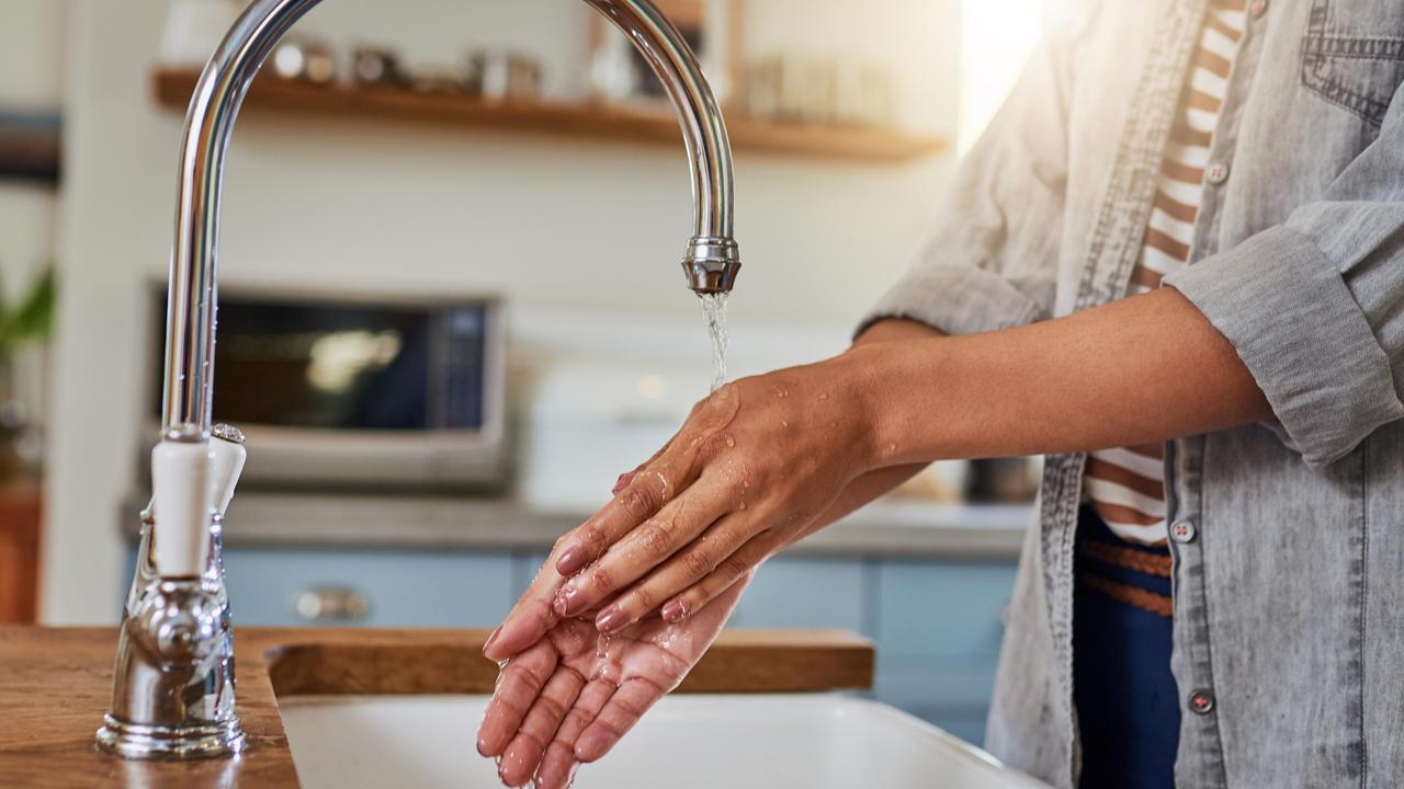 washing hands under running water