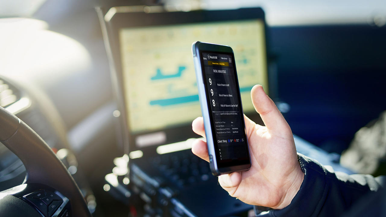 Police officer using smart phone app