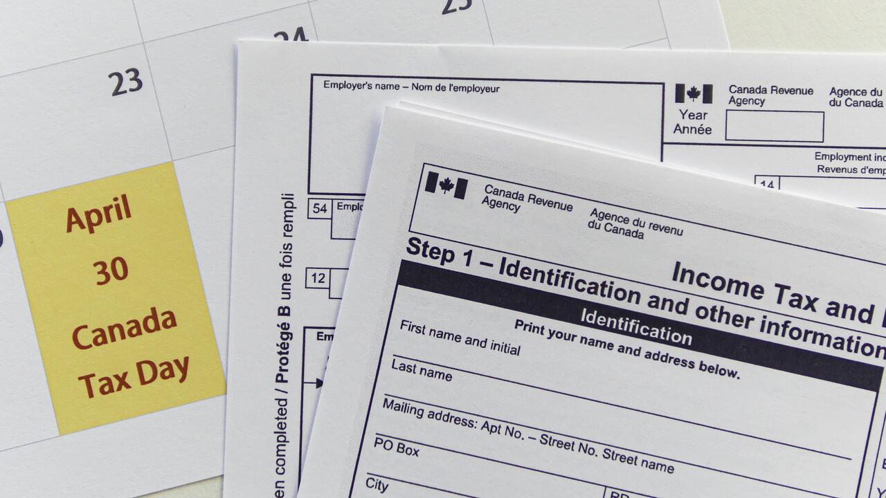 Tax filing papers beside a calendar