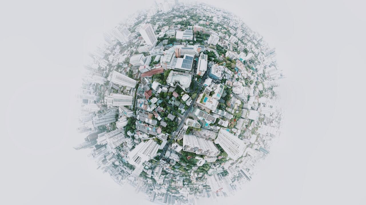 Globe with buildings and trees built on the surface