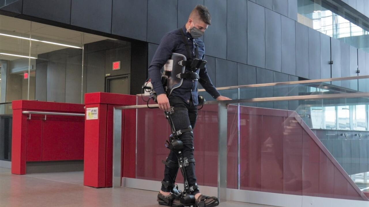 PhD candidate Brokoslaw Laschowski wears an exoskeleton during testing in Engineering 7.